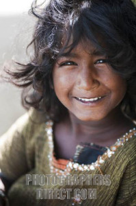young poor indian girl happy smile shallow DOF